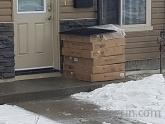 Courier: left package under doormat